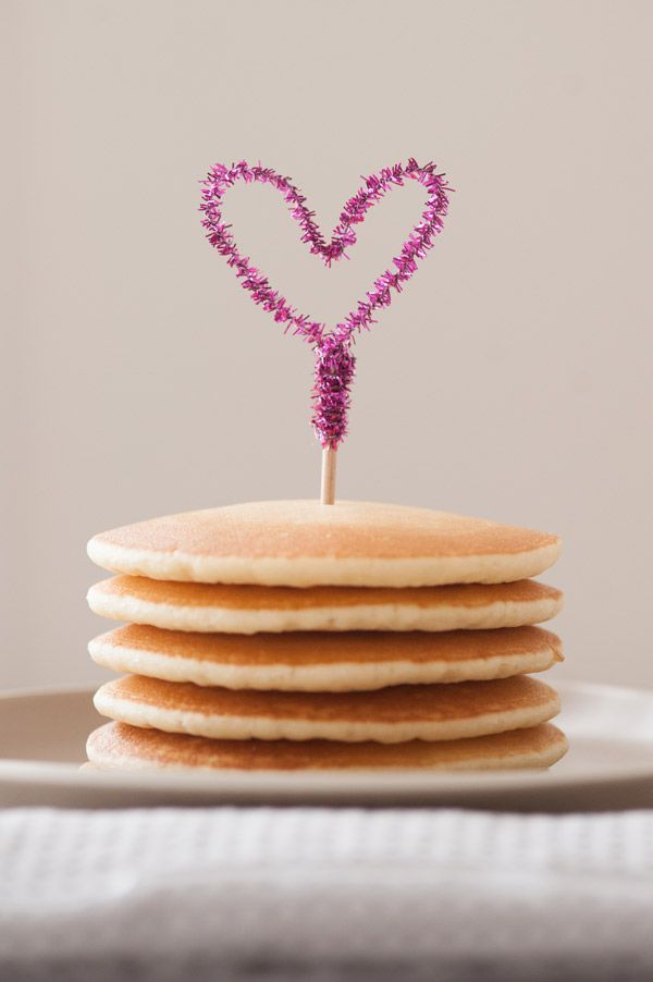 Top a sweet stack of pancakes with a DIY sparkle heart topper that can be made in under a minute using a pipe cleaner. Perfect for Valentine's Day or for your wedding day as an easy cupcake topper for the guests!