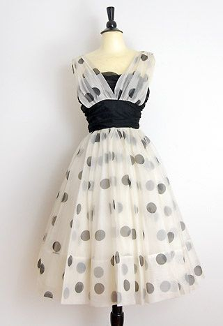 Stunning and gorgeous vintage 1950s formal prom party dress. Layers of white chiffon on poufy skirt with gathered cumberband waist in black. Large polka dots throughout. Top of shoulders have little tabs. This dress is simply adorable and so iconic!
