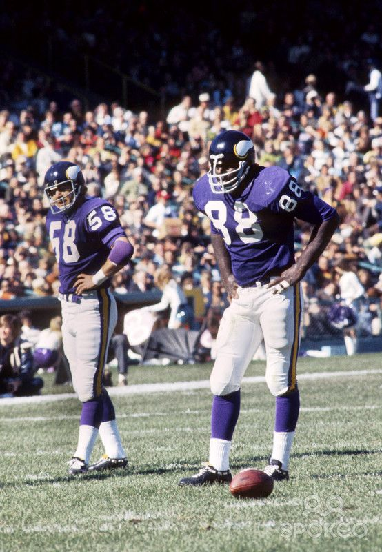 Minnesota Vikings linebacker Wally Hilgenberg (58) and defensive tackle Alan Page (88) on the field against the St. Louis Cardinals at Metropolitan Stadium.