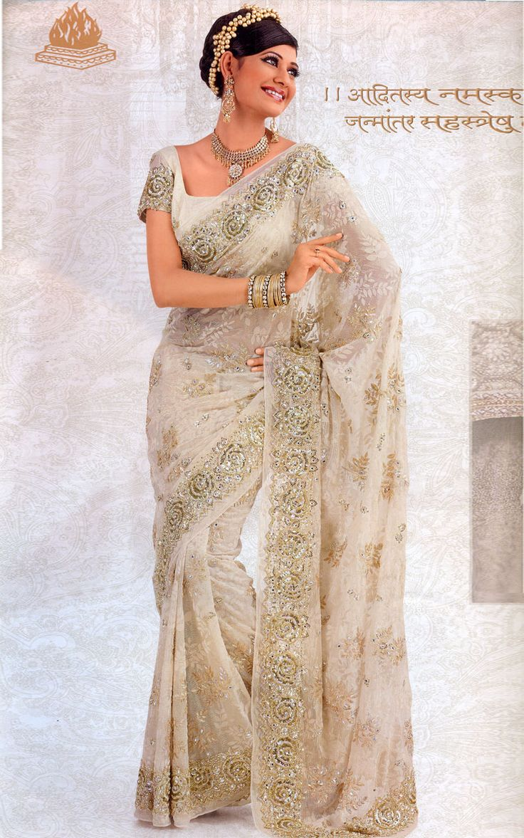A white wedding reception synthetic fancy saree with heavy embriodery from rmkv