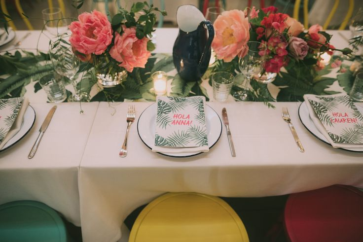 Our table settings. Tommy Bahama table runner, bright chairs