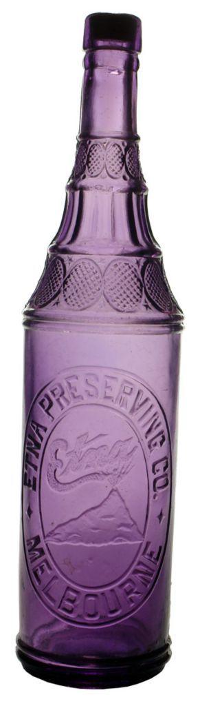 Dark sun-coloured Amethyst Etna Preserving Co Melbourne antique cordial bottle. Etna Volcano trade mark. c1900s-1910s.