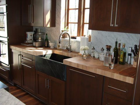 Dream kitchen butcher block countertops dark brown for Brown kitchen cabinets with black appliances