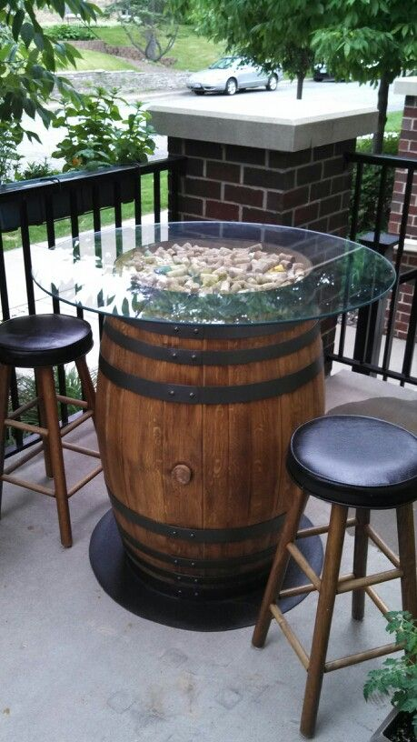 not quite a spool, but a nice use of wine corks & glass to top this barrel patio table...