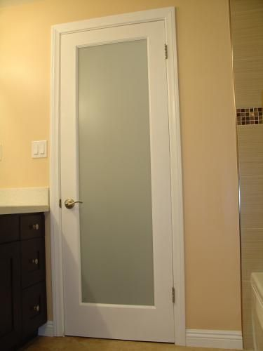 Frosted glass bathroom door Really like this idea to brighten up a long dark hallway, but still have privacy.