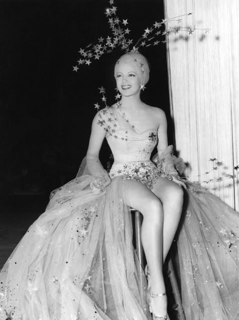 Lana Turner in Gilbert Adrian - 1941 - Ziegfeld Follies Girl - Adrian liked to use star decorations in his costumes, symbolic of their rising star or falling star qualities.