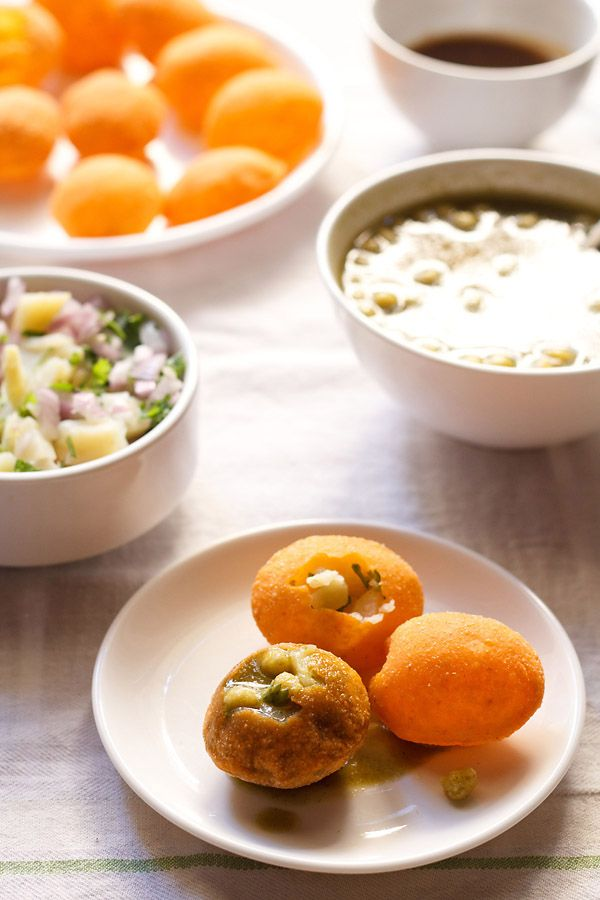 pani puri recipe – a popular indian street food, where crisp fried dough balls are stuffed with potatoes, sprouts, spicy tangy water and sweet chutney.