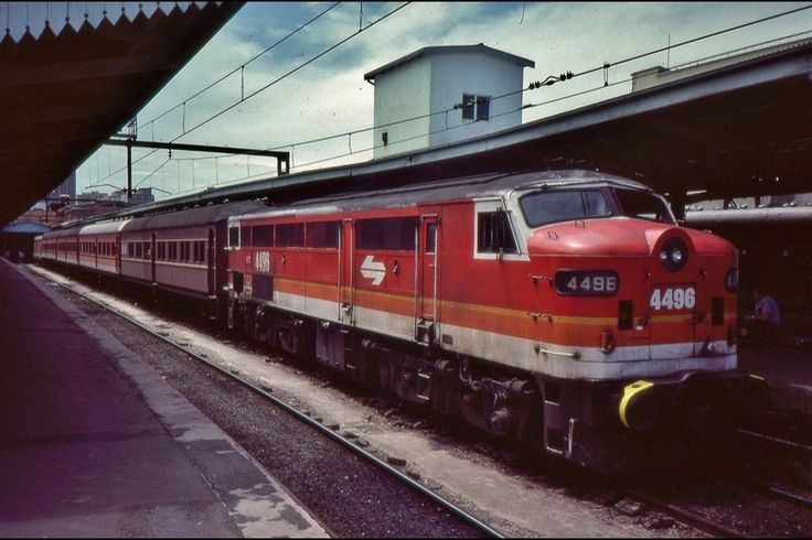 loco 4496 with non-airconditioned carriages sits at Sydney Central station before departure,1984.