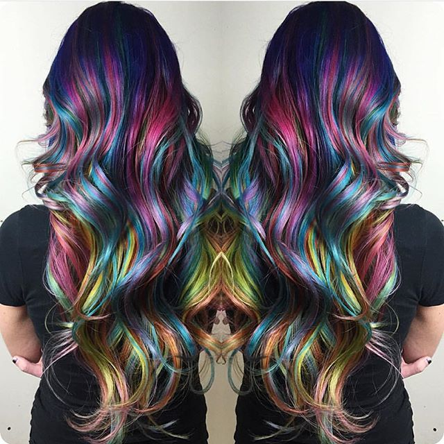 Amazing rainbow hair color and style by Christi Edier hotonbeauty.com mermaid hair unicorn hair long hair long colorful hair