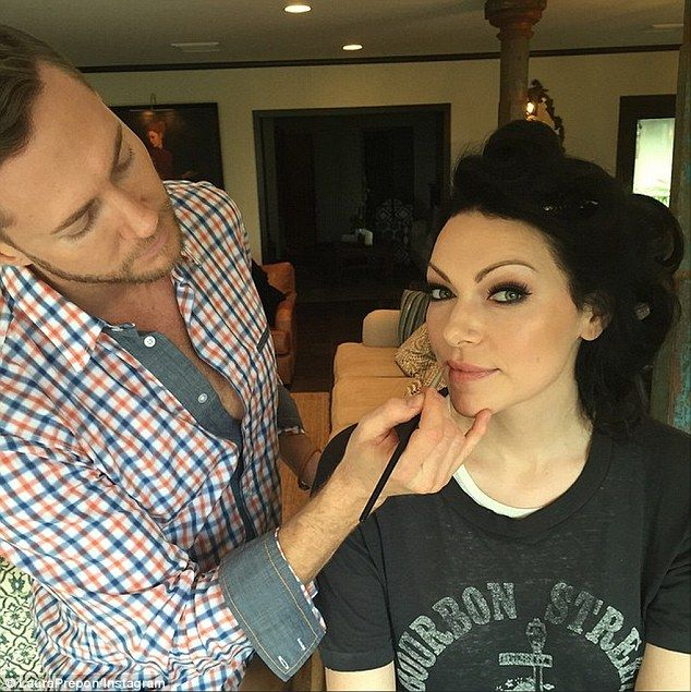 Nice cat eyes: Laura Prepon, who stars in Orange Is The New Black, shared an image of herself getting her lips painted with a light pink color by a male makeup artist