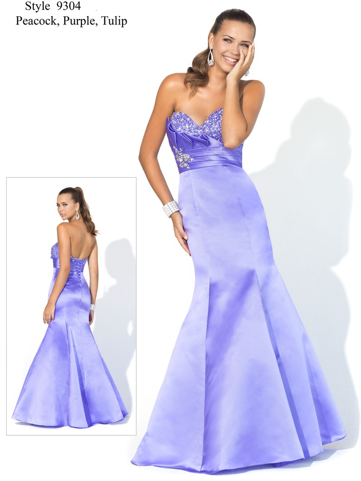 Wear this amazing beaded organza Blush gown to prom. This wonderful dress features a beaded sweetheart neckline that creates a luminous effect. Wide pleats adorn the right side of the bust along with a satin sash for a form-fitting silhouette. A brooch has been placed underneath the pleating for added elegance. A long, mermaid skirt completes this amazing look. Accessorize this look sparingly with silver-toned jewelry!