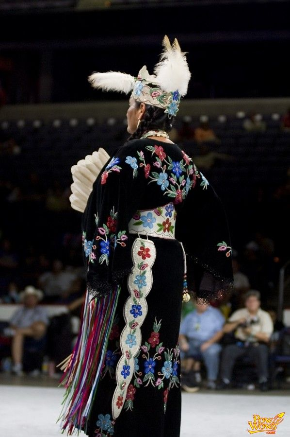 full length floral beadwork on black velvet with tooled leather belt and otter tail.