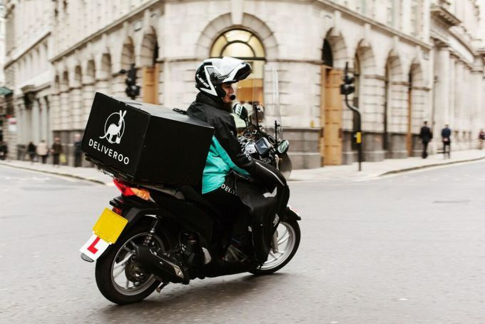 Deliveroo drivers hold protest in London over possible changes to the way they are paid