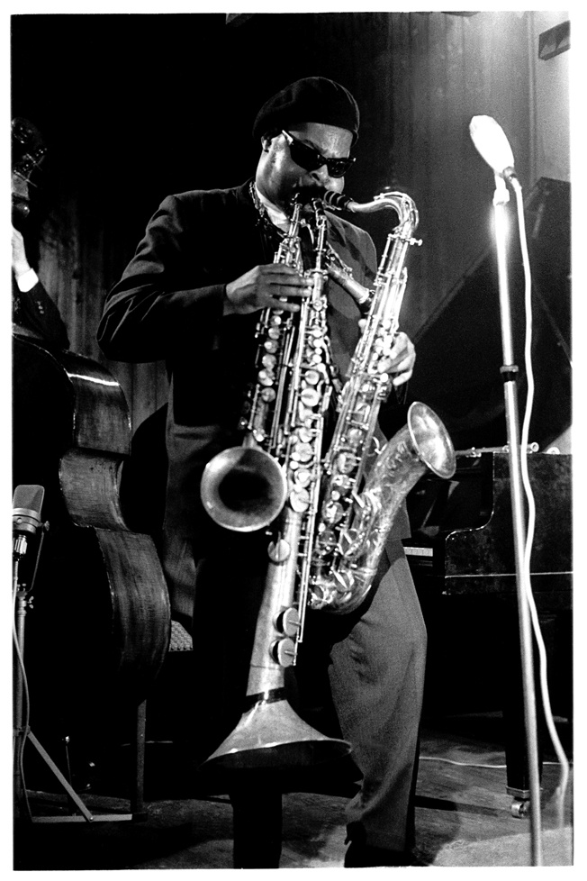 Roland Kirk. Jazz multi-instrumentalist. Known for his exceptional circular breathing, use of musique concrete, and playing multiple instruments simultaneously. Here he is playing tenor saxophone and two obscure saxophones: the stritch (a straight alto sax lacking the instrument's characteristic upturned bell) and a manzello (a modified saxello soprano sax, with a larger, upturned bell).