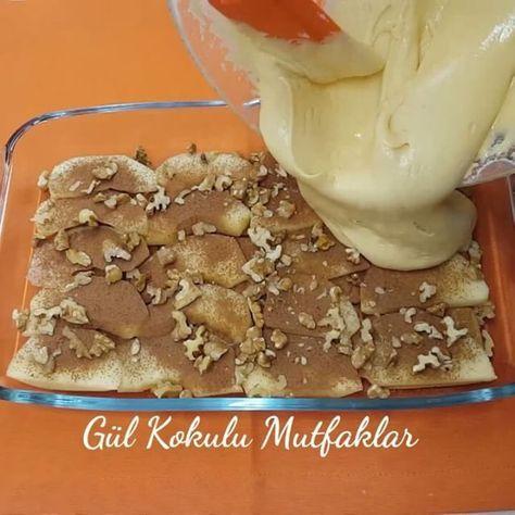 Bisküvili Elmalı Kek Tarifi için Malzemeler 1 adet elma 8-10 adet yulaflı bisküvi 1 çay kaşığı toz tarçın Pudra şekeri 1 su bardağı iri dövülmüş ceviz Kek için;