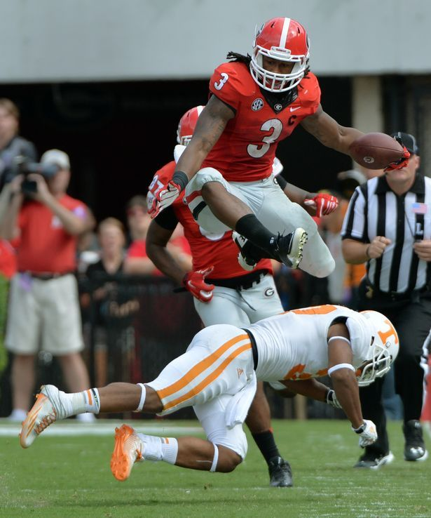 Georgia Bulldogs running back Todd Gurley leaps over Tennessee Volunteers defensive back Brian Randolph during the 4th quarter at Sanford Stadium Saturday September 27, 2014. BRANT SANDERLIN / BSANDERLIN@AJC.COM