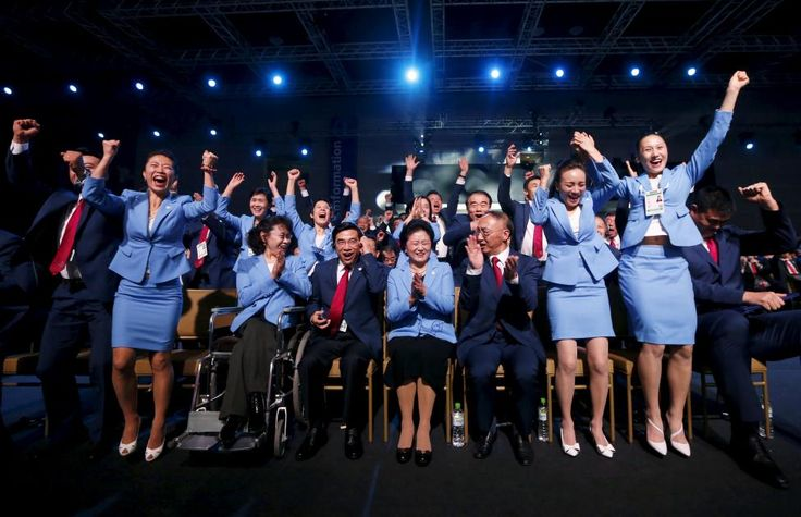 Members of the Beijing delegation celebrate after Beijing was awarded the 2022 Winter Olympic Games, defeating Almaty in the final round of voting, during the 128th IOC session in Kuala Lumpur, July 31, 2015. REUTERS/Olivia Harris