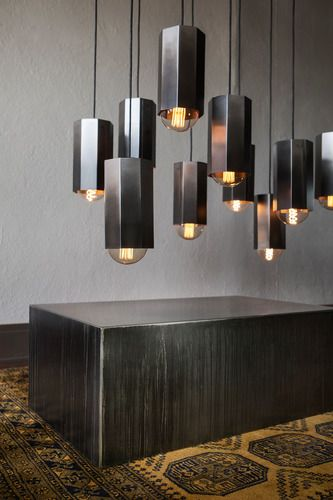 Constructed of steel, then cleaned, stained and buffed by hand to create a truly unique modern lighting fixture, the Hex Light Pendant is a steely beauty, whether hung alone or clustered in multiples.