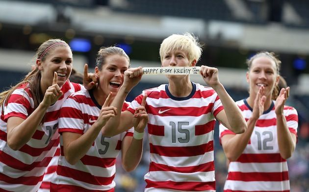 Megan Rapinoe holds up her birthday message to Ali Krieger after scoring. Olympics 2012
