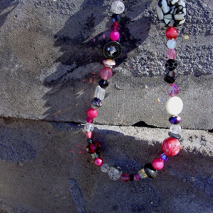 Pink, black & white glass beaded necklace. Makes you think of candy.