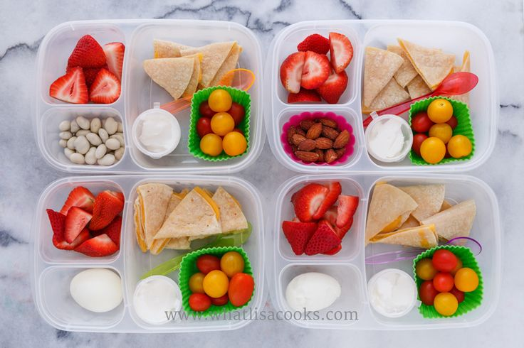Quesadillas on gluten free corn tortillas, tomatoes, sour cream, strawberries. Two have a boiled egg, one has almonds, one has yogurt covered raisins. Packed in EasyLunchboxes, with silicon muffin cups and these dip cups.
