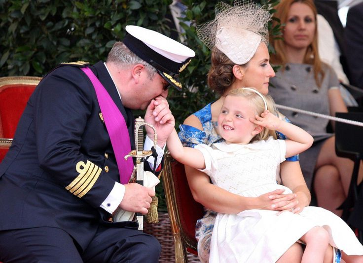Princess Claire with her husband Prince Laurent and their daughter Princess Louise during Belgium's National Day in July 2009.