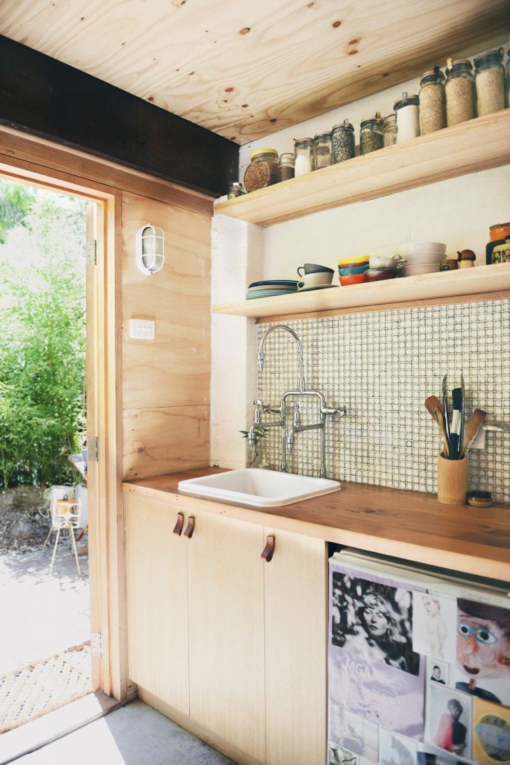 more open shelving in a very small kitchen helps make it feel more open