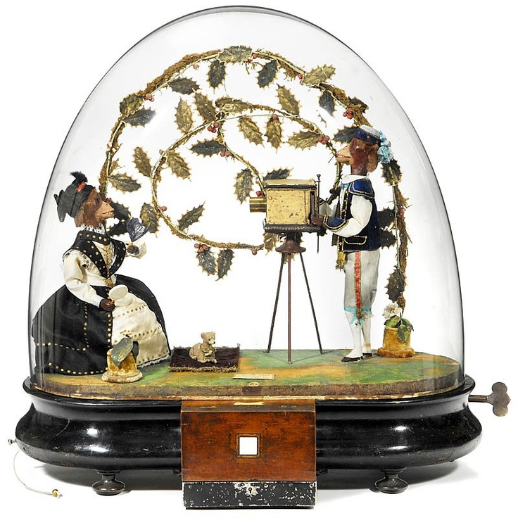 A rare coin-operated musical monkey photographer automaton, made in Paris, ca.1880. One of the stranger antique items I've ever seen. But who doesn't want to watch anthropomorphic moving monkeys taking Daguerreotype photographs?