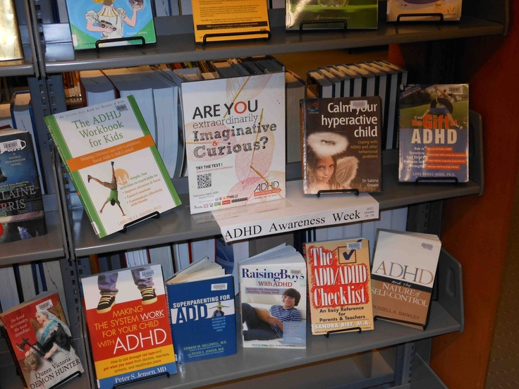 ADHD book display At Burnaby Public Library McGill Branch #3 Metro Vancouver ADHD Awareness Week 2012. By The Vancouver Adult ADD Support Group. The ADHD Awareness Week Logo on the shelf's front was Ed's idea. Photo by Ed.