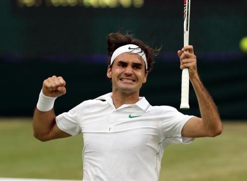 Roger Federer of Switzerland celebrates match point after defeating Andy Murray of Britain in the Wimbledon final on Sunday at Centre Court.