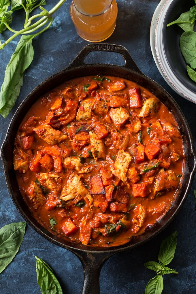 Creamy Paleo tomato basil chicken with butternut squash that comes together in 35 minutes.  Perfectly seasoned chicken in a creamy, flavor-packed sauce with sweet-savory toasty butternut that's Paleo and Whole30 compliant and great for next-day leftovers!