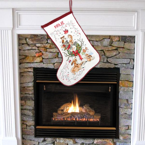 This vintage design is entirely embroidered and sewn by hand and measures approximately 37cm (14.5 inches) long, 20cm (8 inches) wide at the top opening and 2cm (10 inches) from toe to heel.  As each stocking is hand embroidered to order the stocking you receive may have some very slight differences to the one shown in the images. Crafted with 100% cotton.  Personalise with recipient's name.