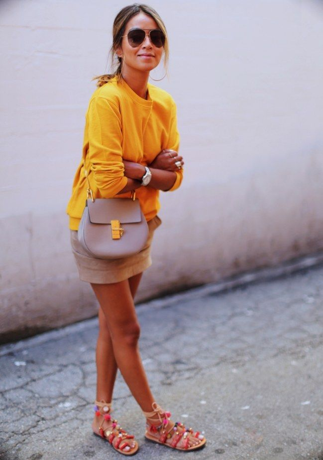 YELLOW SUNSET // yellow sweater and a beige skirt