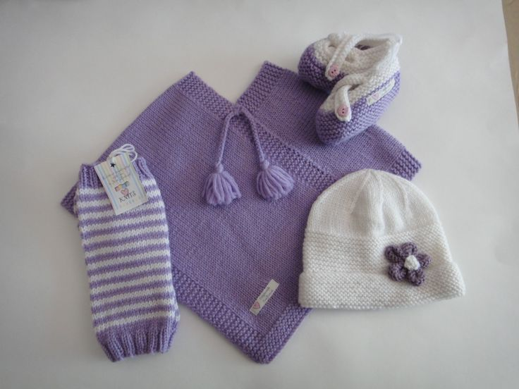 Order now from Babyloveknits.co.nz.    Paypal available. Lilac Poncho, white flower hat, leg warmers and cross over shoes.