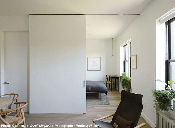 Replace doors with sliding walls to let your space breathe. This Brooklyn apartment feels much larger than its 500 square feet, thanks to large sliding doors with wide doorways.