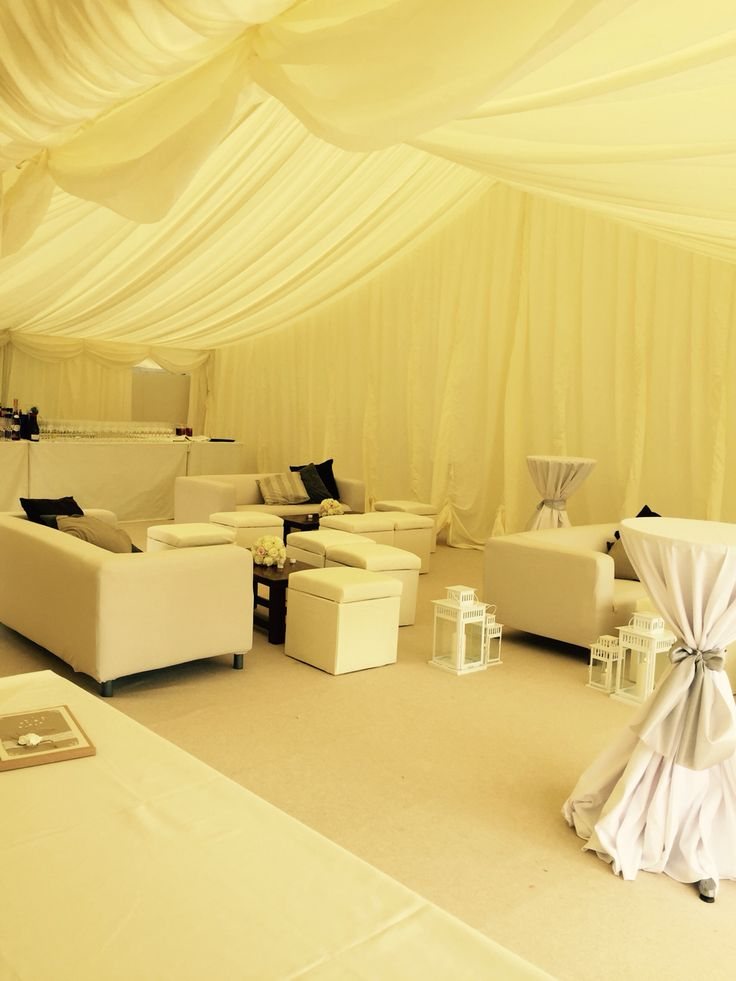 Lounge area in marquee for wedding reception