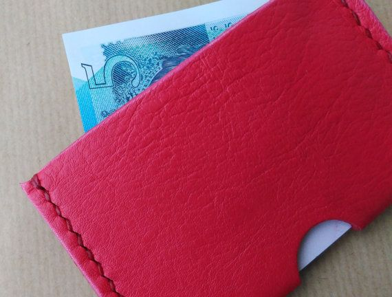 £13.50 A sleek stylish home for a your bank or travel cards. The leather is soft and chic in a bright rockabilly red. It's hand-stitched with scarlet linen thread.  https://www.etsy.com/uk/listing/493543141/slim-leather-wallet-card-holder-red?ref=shop_home_active_10 Slim Leather Wallet, Card Holder, Red, Minimalist, Retro, Brides Maid Gift, Stocking Filler, Christmas Prestent.