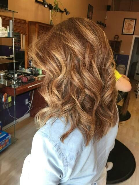 Balayage hair with highlights,  medium shoulder length,  straight cut with bangs. Curls or waves are best to bring out the multi tones.  Love!