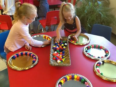 Transforming our Learning Environment into a Space of Possibilities: beautiful round trays and pom poms