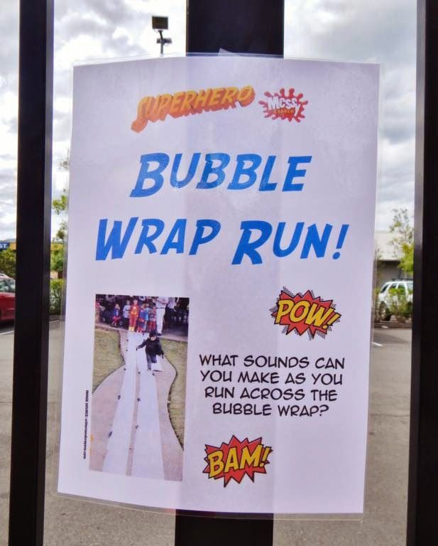 """Bubble Wrap Run game for a Super Hero Party. What a great idea - kids run across a long strip of bubble wrap and see what sounds they make (like """"bam"""" and """"pow""""). Messy Church @ Dapto Uniting: PHOTOS: Superhero Messy Church (Mar 2014)"""