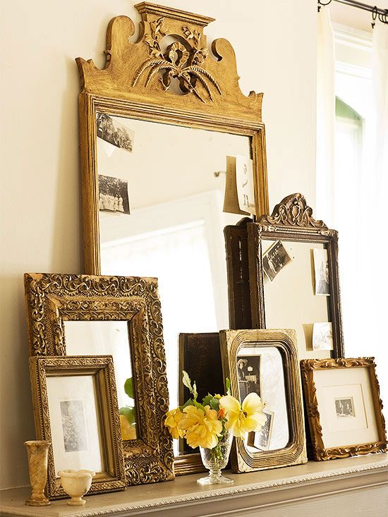 Round out a mantel with a gathering of secondhand mirrors and frames. Golden paint freed the largest mirror in this group -- a $60 flea market find -- from a dark finish, bringing out the piece's architectural charm. Tuck black-and-white photos into the edges of mirror frames for a casual look.