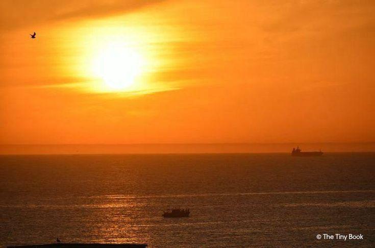 Flowing into the Ocean Agadir Sunset over the sea on the sea of Agadir, Morocco.