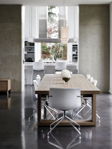 light concrete walls and wood dining table