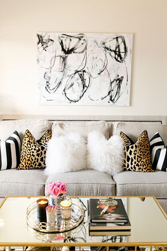 Animal print, stripes, grey couch, neutral paletter, texture and print emphasis. Dawnsboutique: 5 Ideas To Accessorize Your Home On A Budget