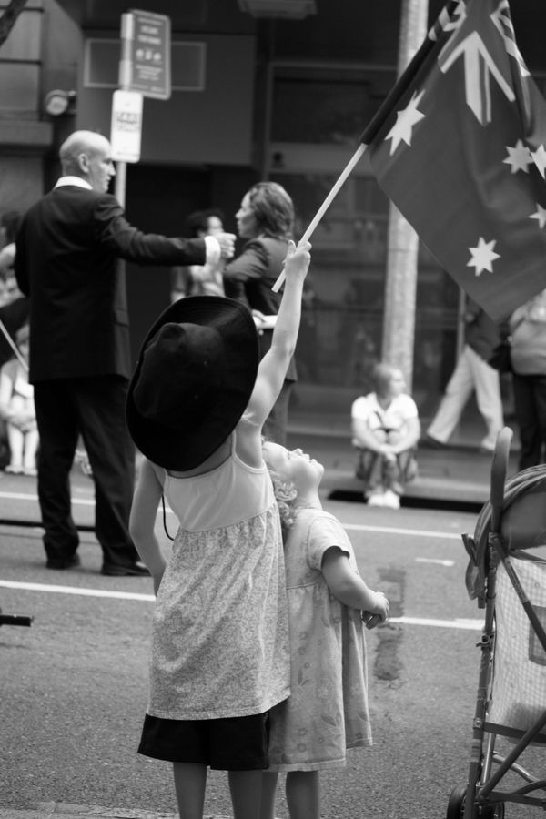 A long, proud Australian tradition: ANZAC Day, April 25th. A day for remembering our brave soldiers. Pictured, a young child proudly waves the Australian flag at an ANZAC Day parade (services and parades are held across the country).