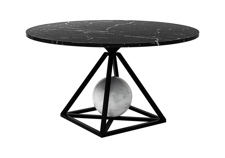 """Multiple geometries converge in the stunning Marble Contrepoids dining table by Pool for the Future Perfect. The piece comprises a round Nero Marquina–marble top, a Carrara-marble sphere, and a pyramidal lacquered-metal base. Measuring 29"""" h. x 59"""" dia., it costs $17,250. thefutureperfect.com, 877-388-7373"""