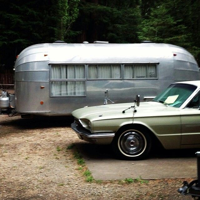 Different window layout on old Airstream. Paired with a 66 TBird, my idea of a great get-away!
