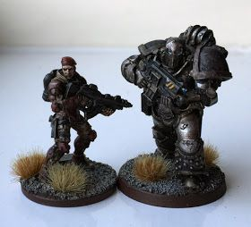 Infinity model on left, true scale space marine on right.