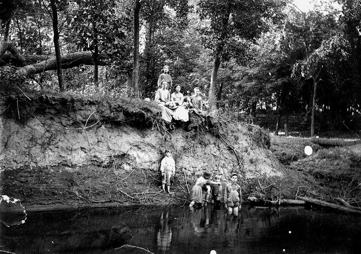 1912 photo by G Harry. Elvina and the older girls are on the bank and May is in the water with the younger boys.