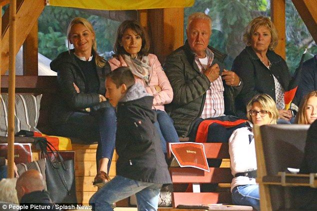 Family affair: Grandparents Rolf Schumacher and Corinna's mother Gabriele Betsch (far right) were also there to cheer on Gina-Maria